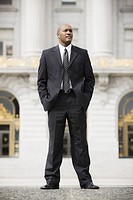 Businessman standing outside office building, San Francisco, California, USA