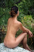 Sits woman, young, bare, outside, back view, beauty, wellness,