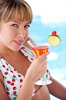 woman having a cocktail drink
