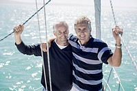 Men hugging on deck of boat