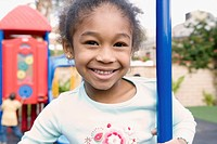 Girl smiling on school playground (thumbnail)