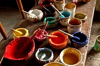 Paints being used in the resortation of a buddhist statue Tiksey, Ladakh, India