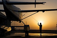 UAE, man claening his plane at the airport of Umm al Quain