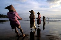 Fishermen at Pangandaran beach, Java, Indonesia