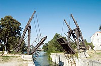 Wooden drawbridge. This cantilevered bridge is a copy of the bridge made famous by Van Gogh in his painting ´The Langlois Bridge at Arles´. The origin...