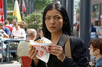 Woman with doner kebab, fast food
