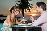 Young couple enjoying a meal together at sunset in Cape Town, Western Cape Province, South Africa