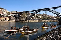 'Rabelos' Port wine carring barges, Douro river and Dom Luis I Bridge, Porto, Portugal