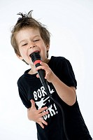 boy sings with microphone