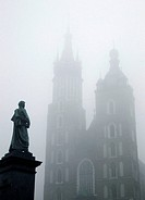 Poland Krakow Church of St Mary at Main Market Square at foggy day