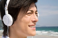 Japanese man listening to music
