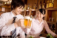 Office workers enjoy drinking a beer