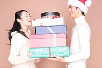 Man handing a lot of gift to woman