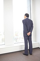 Chief executive officer looking at outside from room