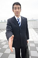 Businessman trying to shake hands (thumbnail)
