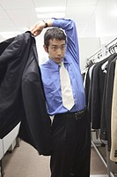 Businessman putting on a suit