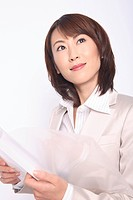 Business lady holding a file in a hand