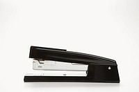 Side view of black stapler on white background
