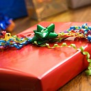 Presents wrapped and decorated with bows on a table (thumbnail)