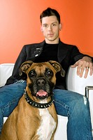 Young adult Caucasian male with Boxer dog