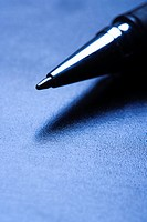 Blue tone close_up of pen tip