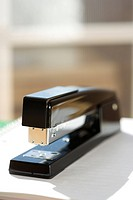Black stapler with window in background
