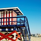 Lifeguard tower painted red, white and blue with stars and stripes on beach in Miami, Florida, USA