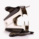Staple remover on white background with selective focus