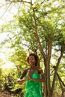 Mid-adult Black female in woods meditating (thumbnail)
