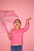Female Hispanic girl with umbrella