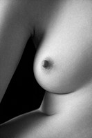 Nude young adult Caucasian female breast