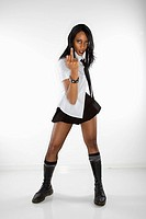 Mid-adult African American woman in mini skirt and boots making obscene gesture at viewer (thumbnail)