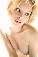 Half length portrait of nude attractive young adult Caucasian blond woman