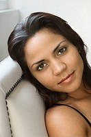 Head shot of Hispanic woman looking at viewer