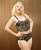 Attractive Caucasian woman posing in retro lingerie
