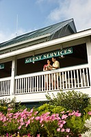 Mid_adult couple on deck of guest services at Bald Head Island, North Carolina