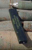 A C_4 explosive placed on a 100 millimeter armor piercing round