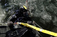 Navy Diver gets ready to start his dive off the back of a dive training boat