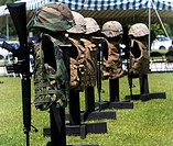 Memorials of flak jackets and Kevlar helmets form a temporary monument