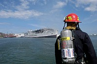 U.S. Navy Sailor responds to a shipboard fire aboard a passenger ferry