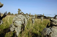 Soldiers prepare to board a UH_60 Black Hawk helicopter