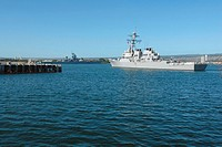 USS Russell passes the Battleship Missouri Memorial as it gets underway
