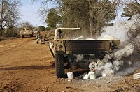 A humvee burns after a simulated roadside bomb explosion
