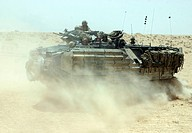 Amphibious assault vehicle kicks up dust