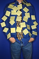 Portrait of Caucasian teen boy covered with sticky notes