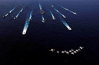 U.S. Navy aircraft fly over a formation of U.S. and Japanese ships