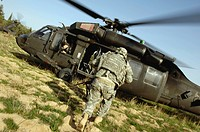 Army soldiers board a UH_60 Black Hawk helcipoter
