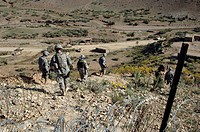U.S Army Soldiers walk back to their humvee