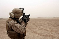 Marine fires the M_32 Multiple shot Grenade Launcher