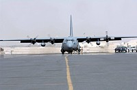 Ground crews prepare a C_130 Hercules for take off